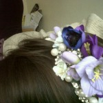 A headband with a lot of random things glued on - silk flowers, fake pearls, broken old brooches. Mousey hair, model's own